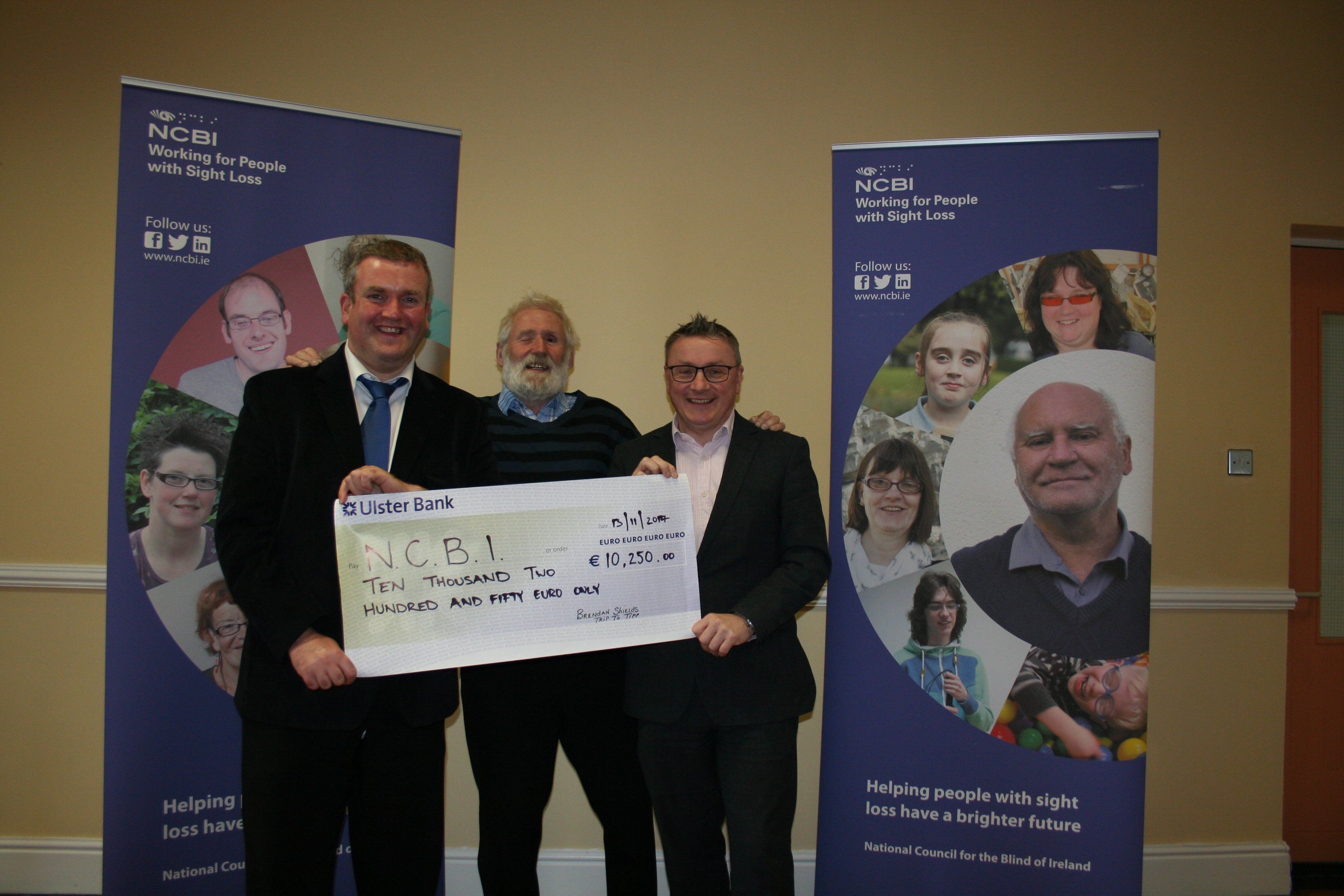 Photo is of Brendan Shields , Billy Shanahan and Chris White holding a large cheque in the NCBI offices in Drumcondra, Dublin