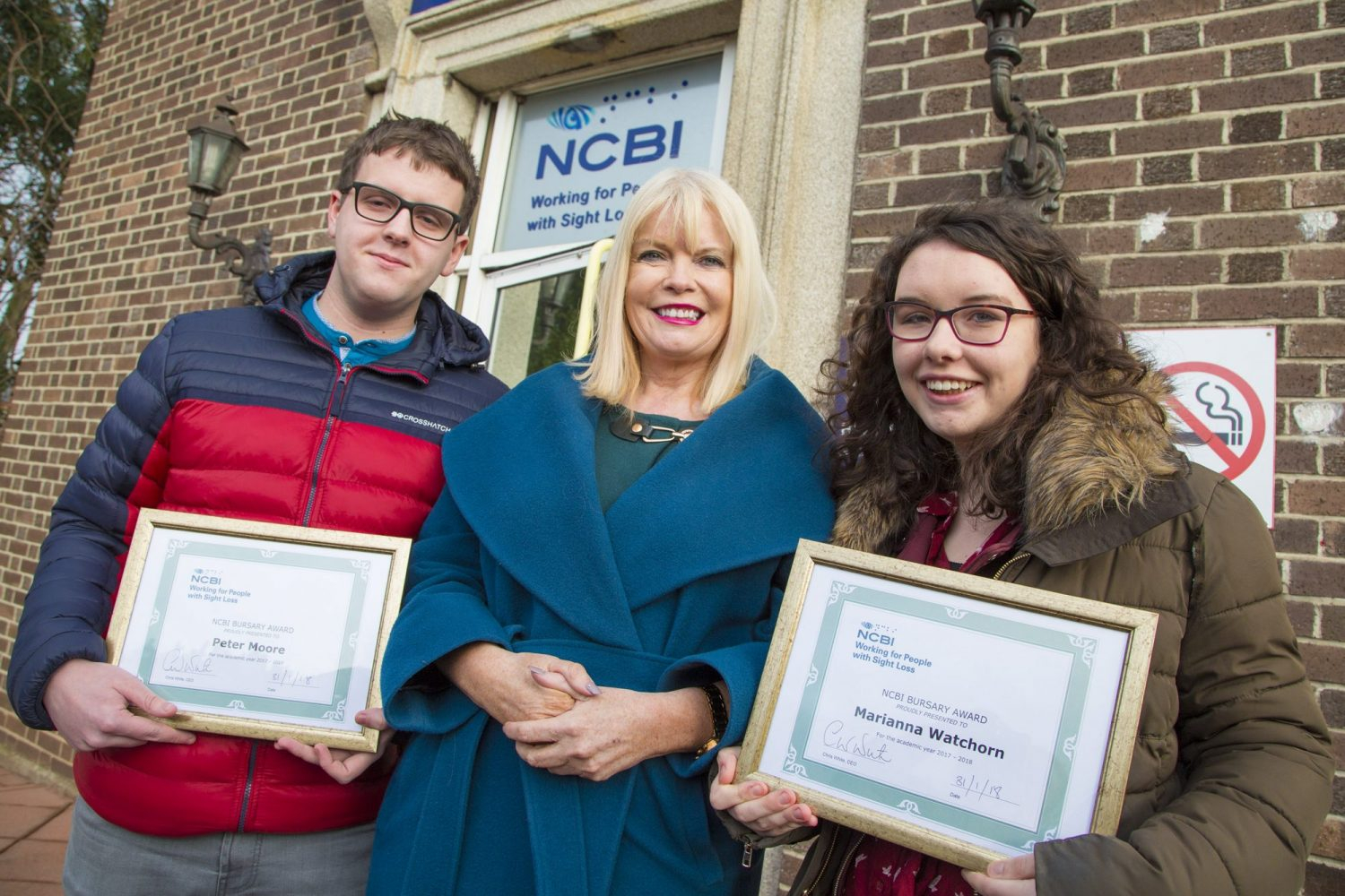 Left to Right: NCBI Bursary Award winner Peter Moore, Minister Mary Mitchell O'Connor, T.D., and NCBI Bursary award winner Marianna Watchorn.