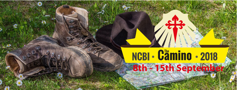 Boots, map and hat on grass with text: NCBI, Camino, 2018, 8th-15th September