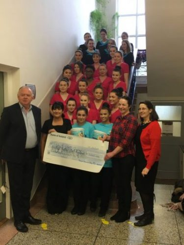 group photo of the students with the principal, two teachers and NCBI's Aileen Ahern with the cheque