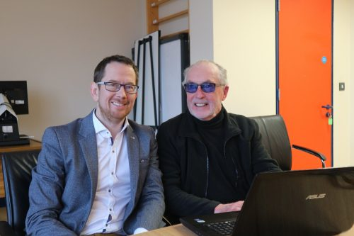 Photo of William Priestly and Tony Geary sitting together in the NCBI office in Limerick