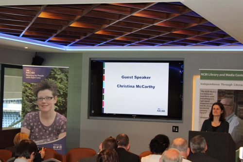 Photo of Christina McCarthy speaking at an NCBI Library event