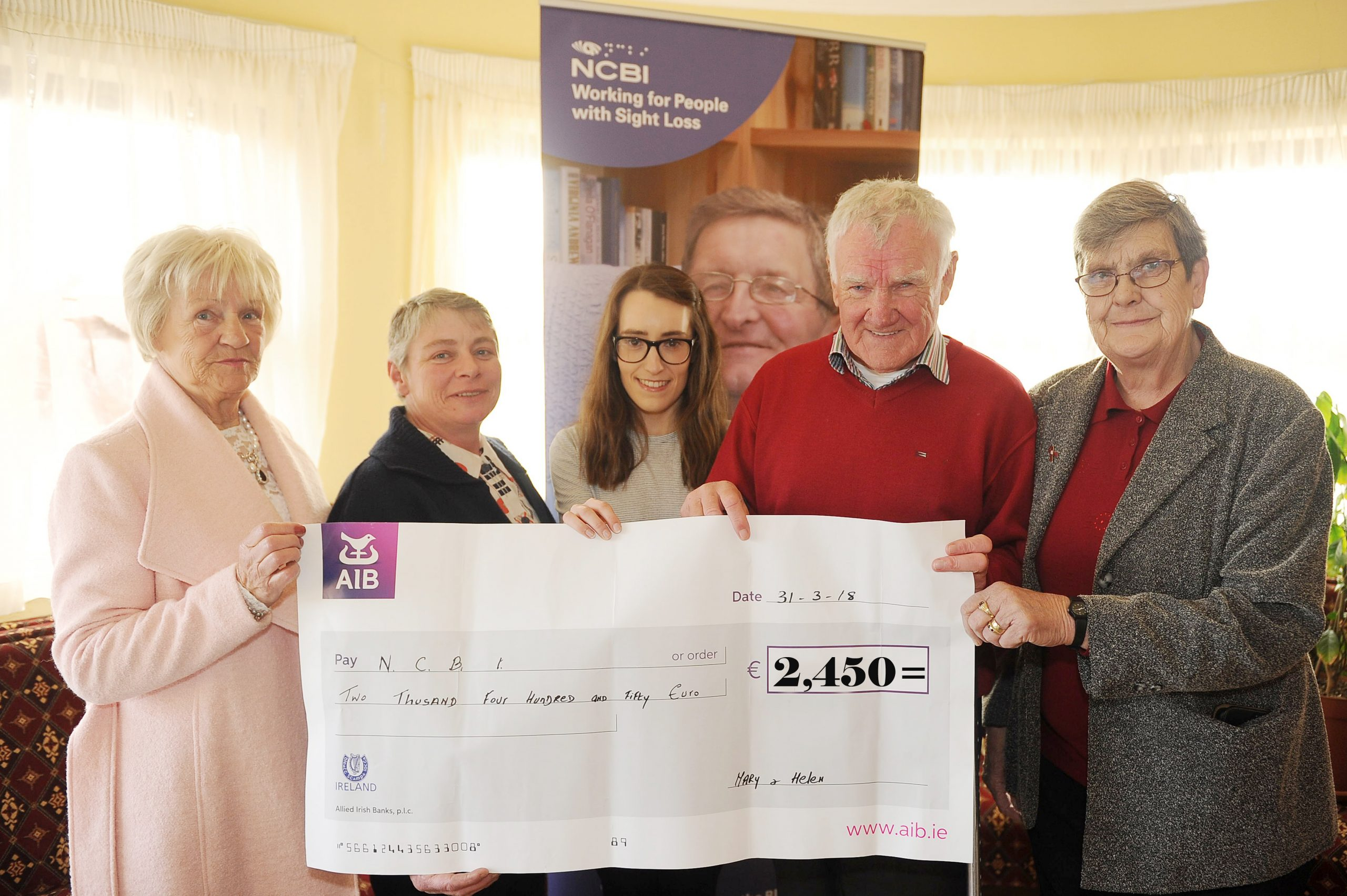 Photo is of Anne Creagh, Helen McEvoy, Lisa Connaughton, Sean Creagh and Mary Madden holding a large cheque for 2,450