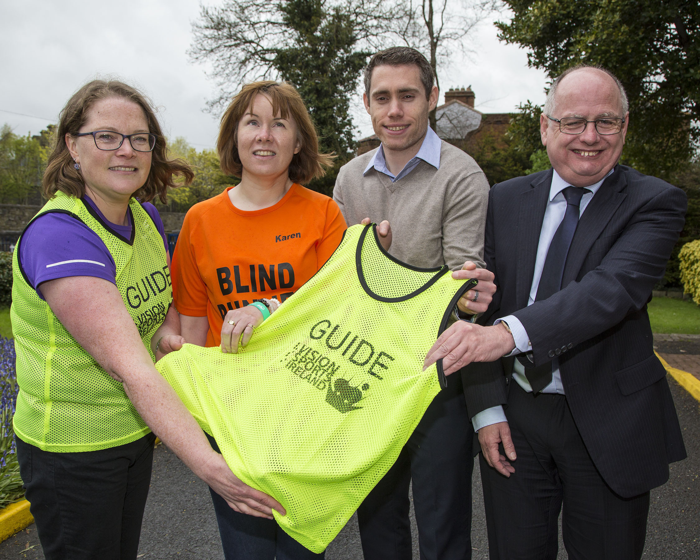 Pictured is Joan Ryan , Karen Kealy, Jason Smyth and Joe Geraghty holding the sighted guide bib