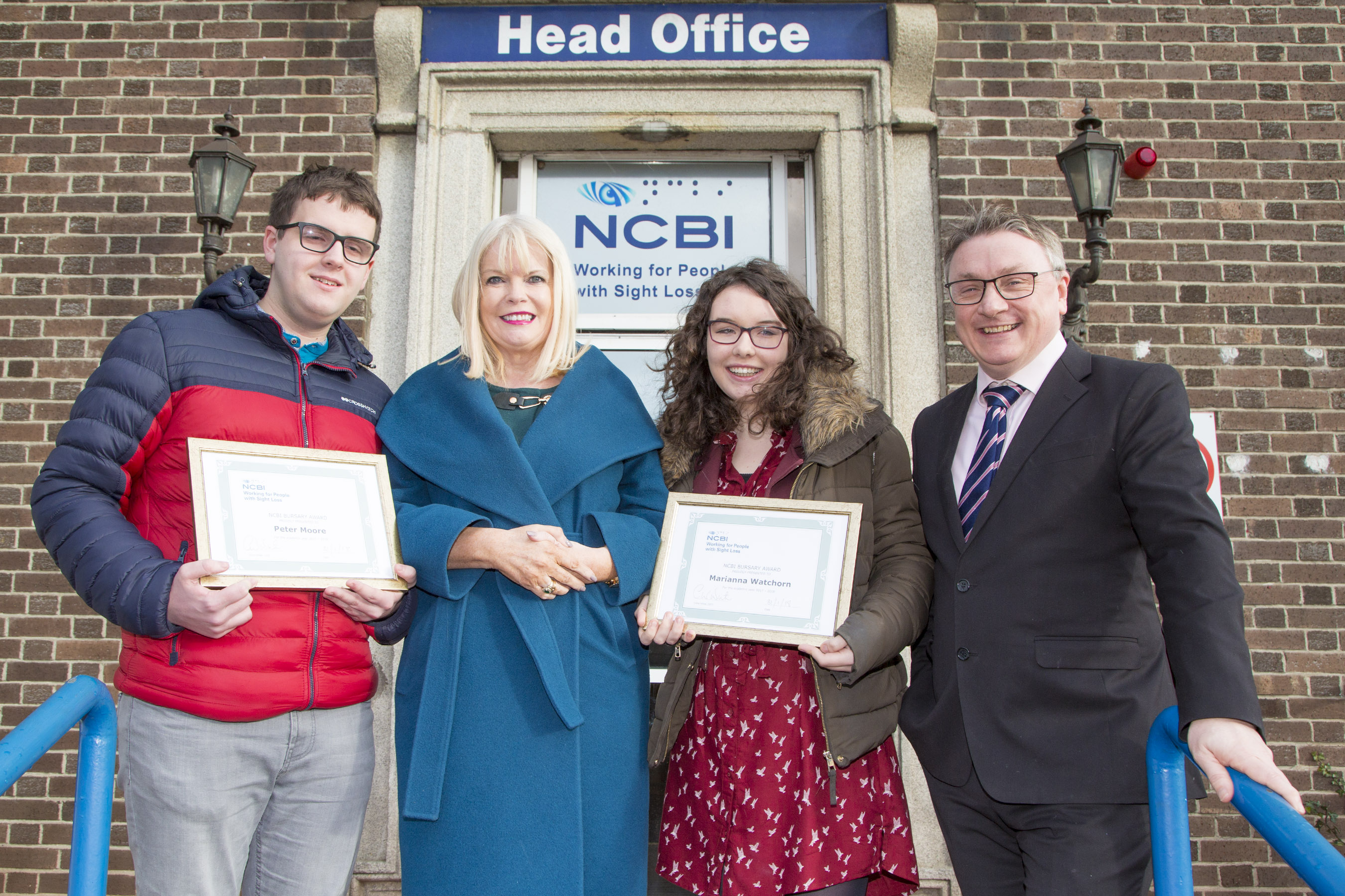 Minister Mary Mitchell O' Connor pictured with Chris White NCBI CEO and 2017 Bursary recipients Peter Moore and Marianna Watchhorn