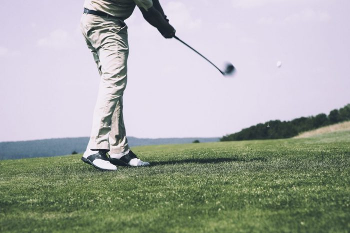 Image of a man golfing