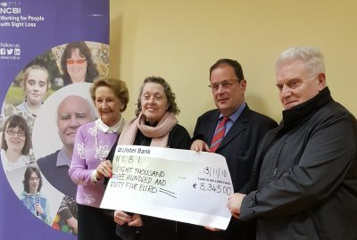*image of Angela, Jean, Ruairi (of NCBI) and Kevin holding presentation cheque