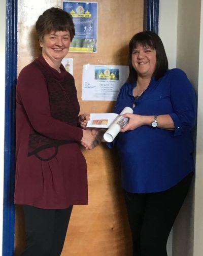 Image caption: Geraldine Conway presenting Colette Quinlivan of NCBI with her generous donation.