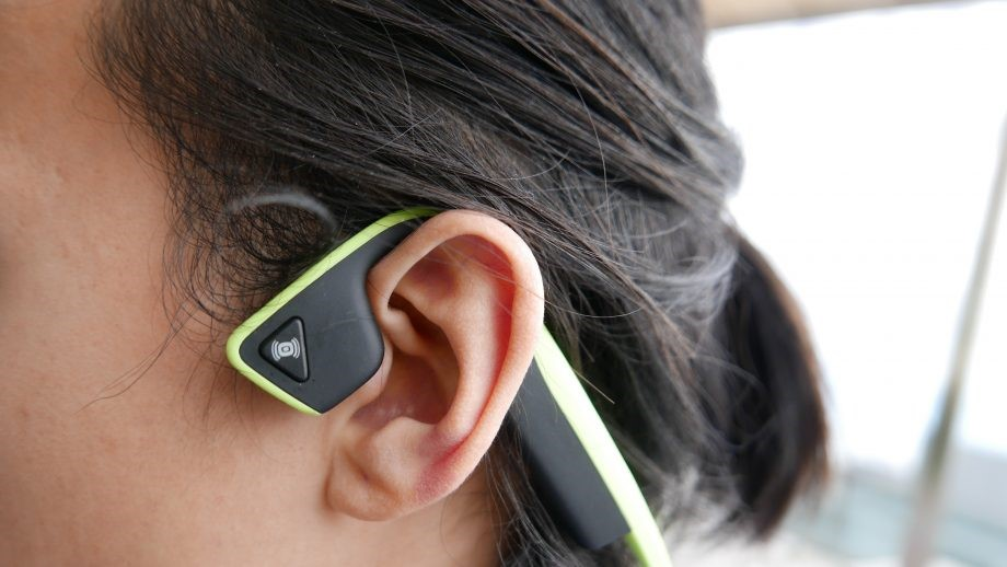 Image of a person wearing a set of bone conducting headphones