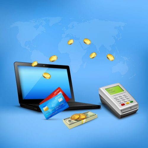 Laptop, credit cards, cash money, coins and a card reader on a blue background