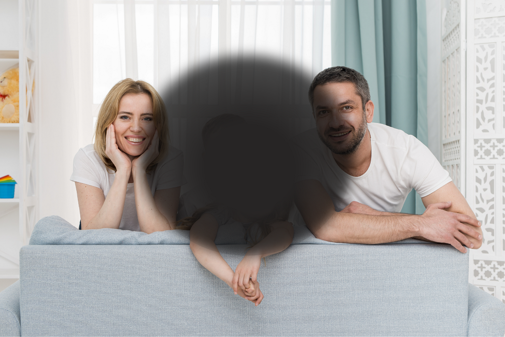 Photo of a family with a black spot in the middle to simulate central vision loss