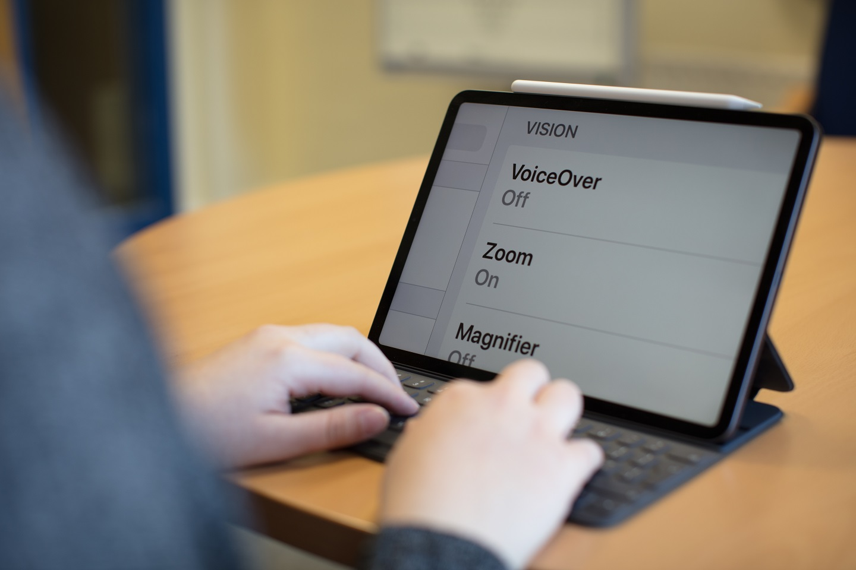 Image of adult using ipad keyboard
