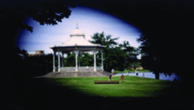 Image of a bandstand in a park with edges blacked out to simulate Peripheral vision loss