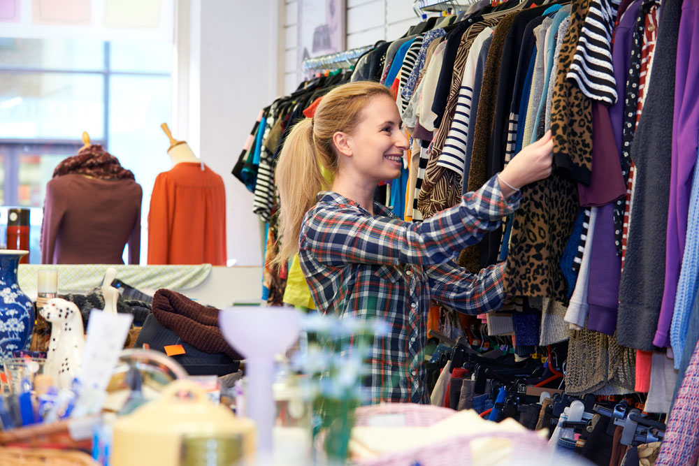 Lady browsing clothes in NCBI Fashion Store