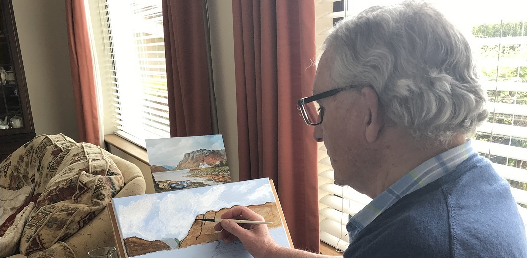 Barry White painting a landscape