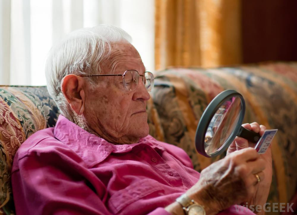 Service user using a magnifying glass to see a card