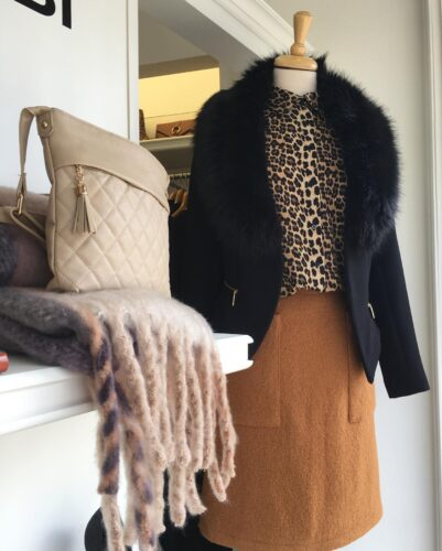NCBI outfit: A beige letter purse, black jacket and a brown skirt