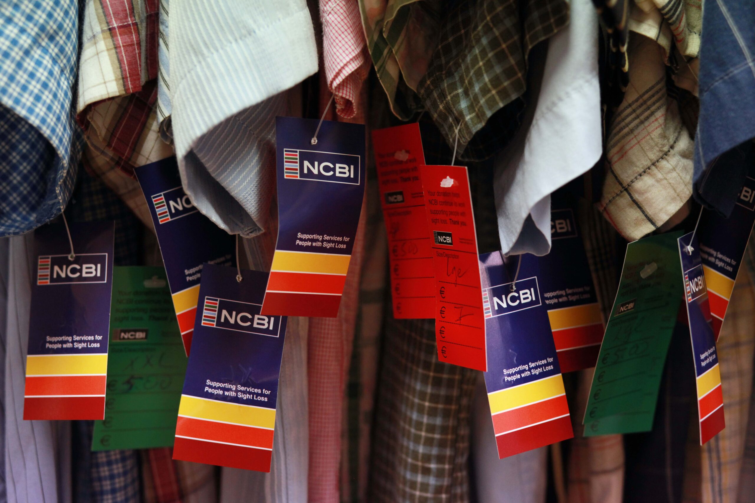 Rail full of clothes with NCBI price tags