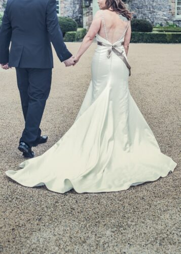 photo of the groom and the bride walking