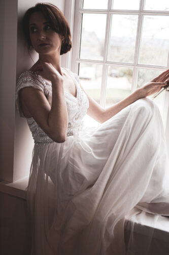 Bride sitting at the window