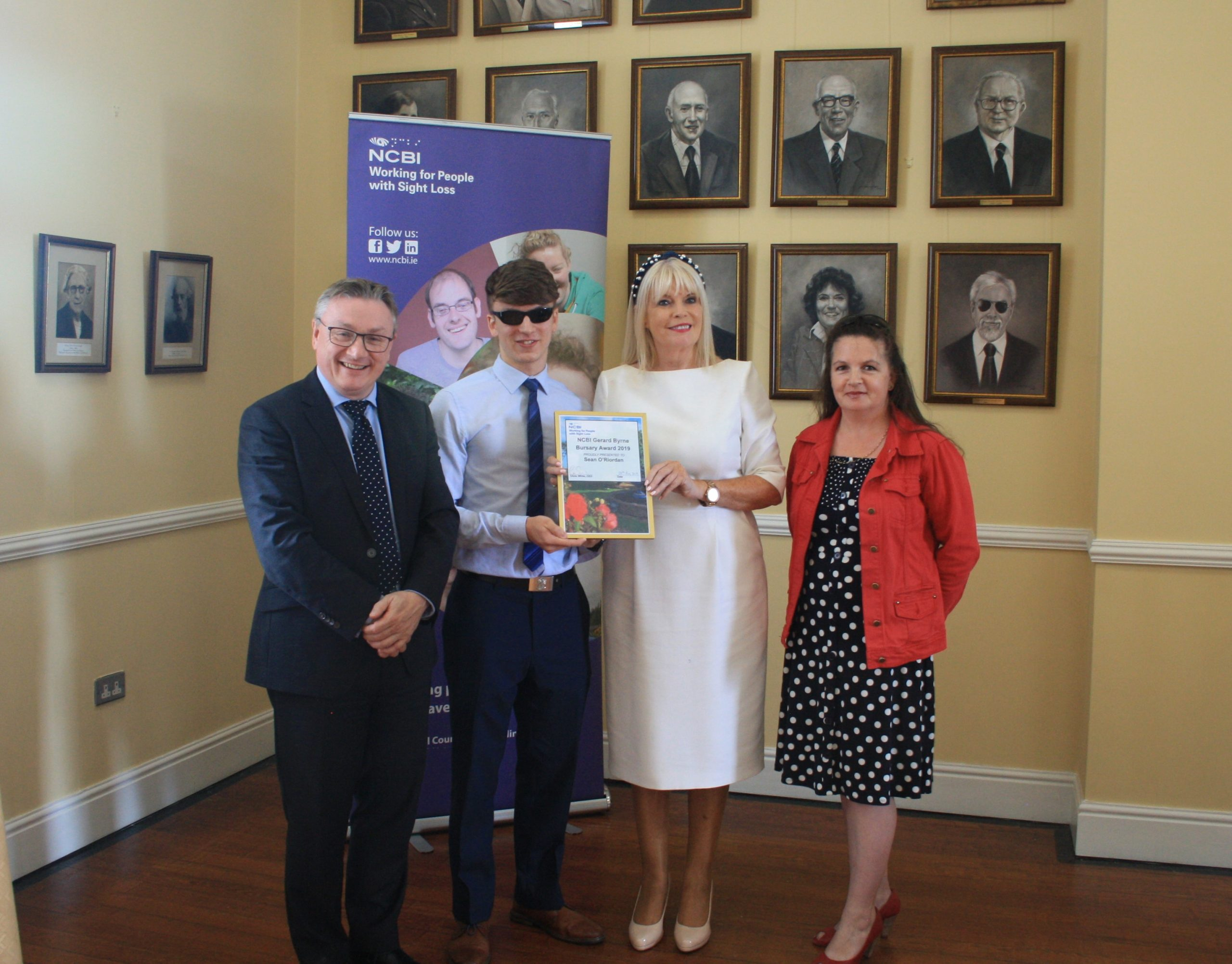 NCBI Bursary presentation to Sean O'Riordan l-r CEO Chris White, Sean, Minster Mary Mitchell O'Connor TD and Mother of Sean