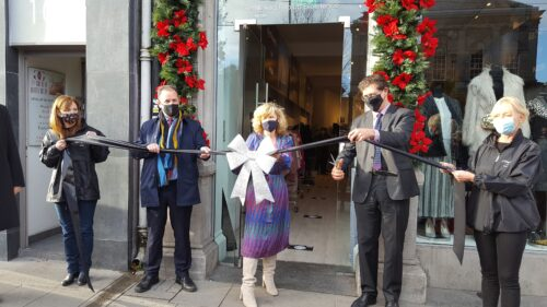 Photo of 5 people cutting the ribbon in front of the pop-up shop on Grafton street
