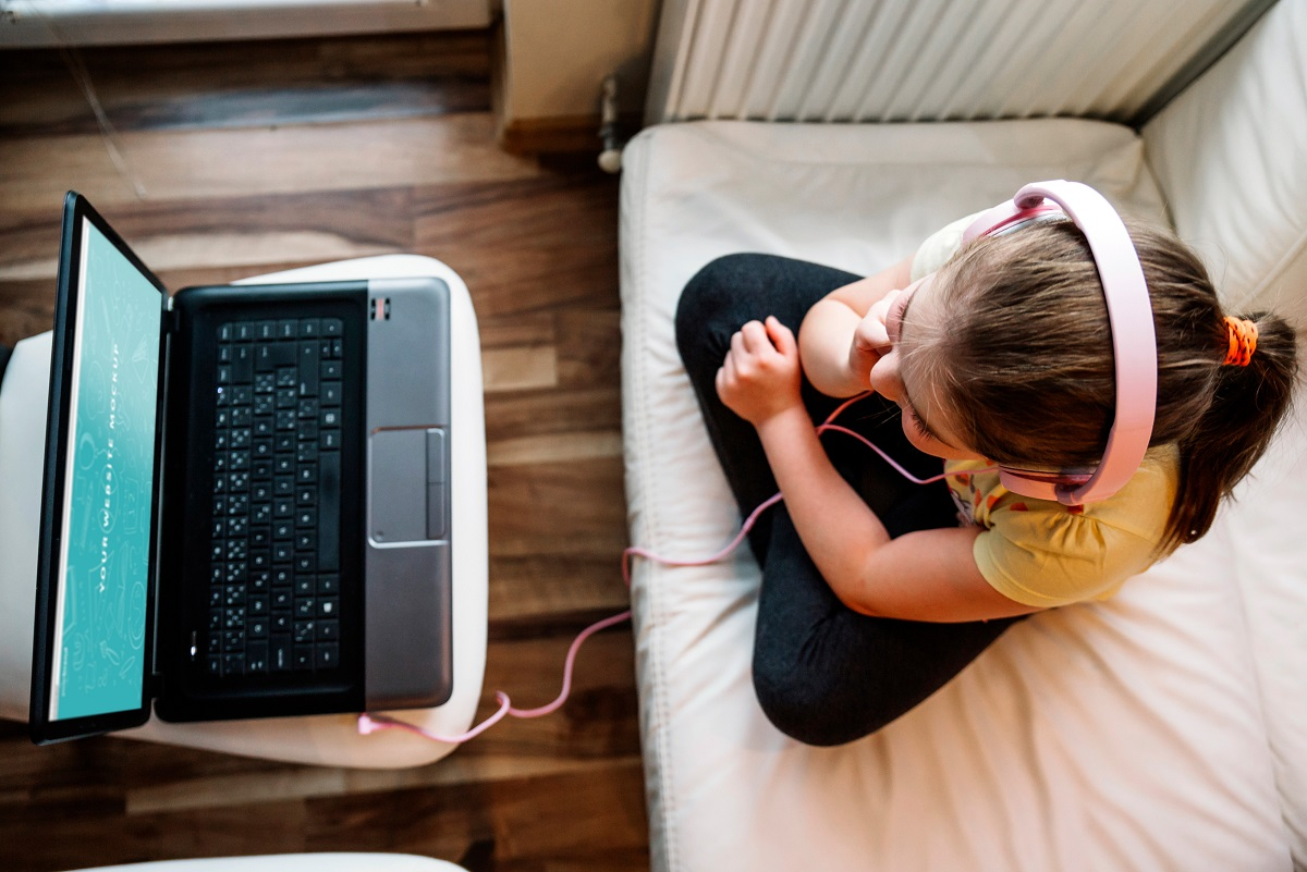 A young girl in front of her computer