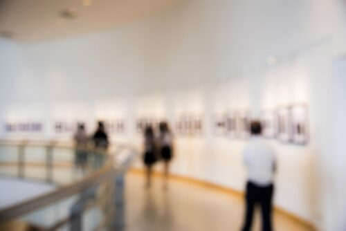 blurred image People enjoying an art exhibition