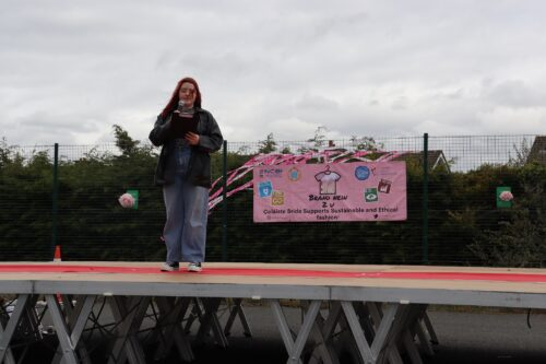 A girl speaking using a microphone