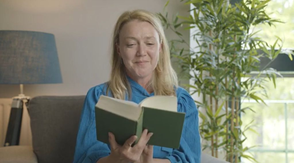 Blond woman reading a book