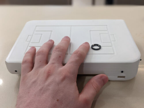 """image of the new """"Field of vision device"""" which is a small version of the football field that you can hold with your hands"""