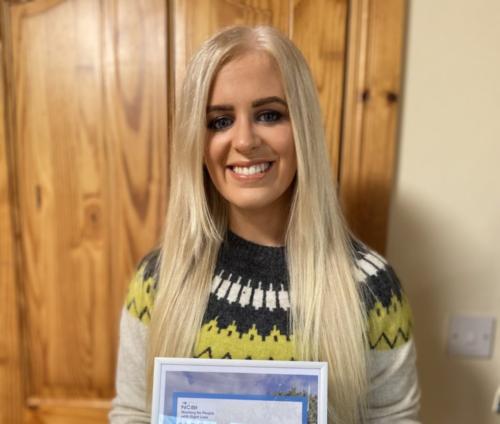 Photo of Megan with her Bursary certificate