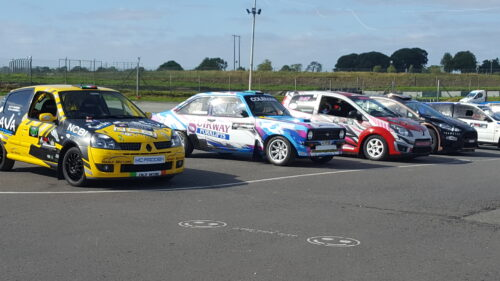 Race cars parked on the track