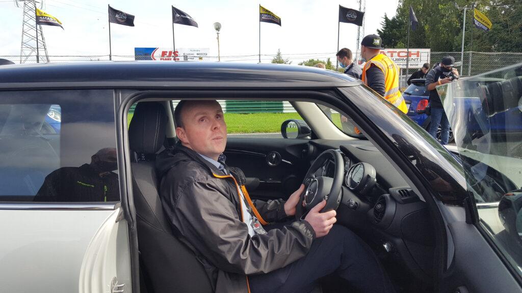 Participant behind the wheel of a Mini car