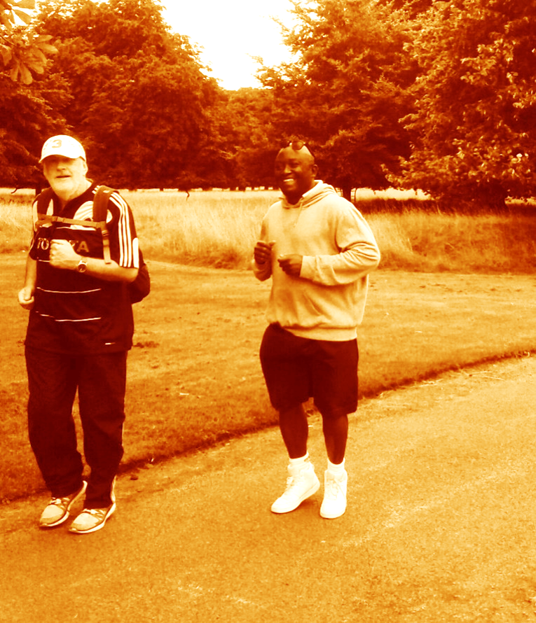 Image of Jerry and David running side by side in the park